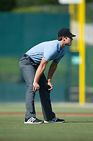 Umpire Zach Neff handles the calls on the bases during the South Atlantic League game between the Delmarva Shorebirds and the Kannapolis Intimidators at Kannapolis Intimidators Stadium on July 2, 2017 in Kannapolis, North Carolina.  The Shorebirds defeated the Intimidators 5-4.  (Brian Westerholt/Four Seam Images)