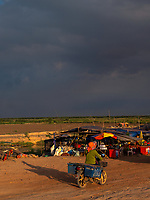 A storm approaches during the Monsoon Season on the outskirts of the Tonle Sap Lake late afternoon. Activities and way of life, around and near the Tonle Sap Lake, Siem Reap area, Cambodia