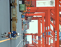 Worker at the Port of Tokyo, Tokyo, Japan. Industrial production in Japan plunged at the steepest pace in 55 years in the fourth quarter, and unemployment rose at the fastest rate in 41 years with exports in the third quarter were a record 13.9 per cent lower than in the previous quarter..19 Feb 2009.