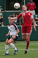 Canada's Rhian Wilkinson (7) heads the ball as USWNT's Amy Rodriguez (8) looks on. The U.S. Women's National Team defeated Canada 1-0 in a friendly match at Marina Auto Stadium in Rochester, NY on July 19, 2009. Abby Wambach of the USWNT scored her 100th career goal in the second half..