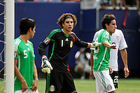Mexico (MEX) goalkeeper Guillermo Ochoa (1) sets his defense. Mexico (MEX) defeated the United States (USA) 5-0 during the finals of the CONCACAF Gold Cup at Giants Stadium in East Rutherford, NJ, on July 26, 2009.