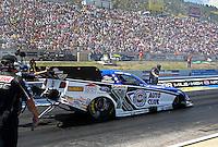 Jul. 21, 2013; Morrison, CO, USA: NHRA crew members for funny car driver Robert Hight during the Mile High Nationals at Bandimere Speedway. Mandatory Credit: Mark J. Rebilas-
