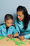 Preschool transition to start of school mother working with son on play dough activity