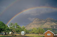 Waterton Lakes National Park, Canadian Rockies, Alberta, Canada - Double Rainbow over Mountains and Campground - UNESCO World Heritage Site