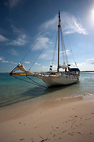 Sailing sloop moored in the shallow water of a beach on Little Water Cay, Turks and Caicos Islands, Caribbean