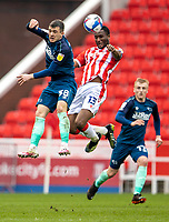 20th March 2021; Bet365 Stadium, Stoke, Staffordshire, England; English Football League Championship Football, Stoke City versus Derby County; John Obi Mikel of Stoke City wins the header in front of Jason Knight of Derby County