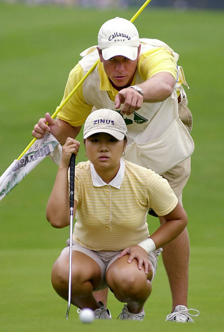 Jeong Jang of Taejons South Korea, left sizes up a putt with assitance from her caddie Brian Dilley, right on the first green during the third round of the LPGA Betsy King Classic tournament Saturday, Aug. 24, 2002 in Kutztown, PA. (AP Photo/Brad C Bower)
