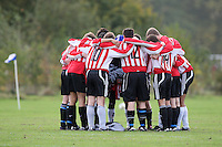 Players of Shoreditch Fire Penguins FC huddle before a Hackney & Leyton Sunday League match at Hackney Marshes - 25/10/09 - MANDATORY CREDIT: Gavin Ellis/TGSPHOTO - Self billing applies where appropriate - Tel: 0845 094 6026