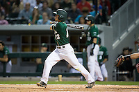 Luke Gibbs (12) of the Charlotte 49ers follows through on his swing against the North Carolina State Wolfpack at BB&T Ballpark on March 31, 2015 in Charlotte, North Carolina.  The Wolfpack defeated the 49ers 10-6.  (Brian Westerholt/Four Seam Images)