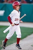 OU bat boy at work during the NCAA matchup between the University of Arkansas-Little Rock Trojans and the University of Oklahoma Sooners at L. Dale Mitchell Park in Norman, Oklahoma; March 11th, 2011.  Oklahoma won 11-3.  Photo by William Purnell/Four Seam Images