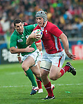 Jonathan Davies breaks away from the Irish defence to score a vital try in the World Cup quarter final in Wellington.