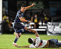 LAKE BUENA VISTA, FL - JULY 26: Roger Espinoza of Sporting KC has his shot blocked by Derek Cornelius of Vancouver Whitecaps FC during a game between Vancouver Whitecaps and Sporting Kansas City at ESPN Wide World of Sports on July 26, 2020 in Lake Buena Vista, Florida.