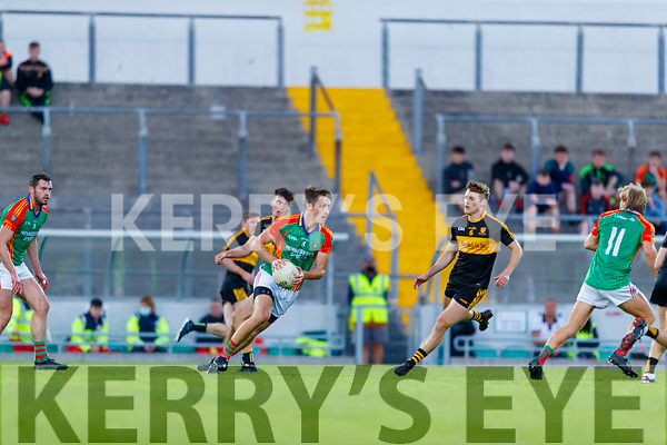Colin McGillycuddy, Mid Kerry in action against Gavin White (Captain), Dr. Crokes during the Kerry County Senior Football Championship Semi-Final match between Mid Kerry and Dr Crokes at Austin Stack Park in Tralee, Kerry.