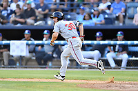 Greenville Drive right fielder Ryan Scott (30) runs to first base during a game against the Asheville Hippies at McCormick Field on June 29, 2017 in Asheville, North Carolina. The Drive defeated the Tourists 9-6. (Tony Farlow/Four Seam Images)