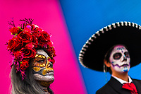 A young couple, costumed as La Catrina, a Mexican pop culture icon representing the Death, takes part in the Day of the Dead celebrations in Oaxaca, Mexico, 31 October 2019. Day of the Dead (Día de Muertos), a religious holiday combining the death veneration rituals of Pre-Hispanic cultures with the Catholic practice, is widely celebrated throughout all of Mexico. Based on the belief that the souls of the departed may come back to this world on that day, people gather together while either praying or joyfully eating, drinking, and playing music, to remember friends or family members who have died and to support their souls on the spiritual journey.
