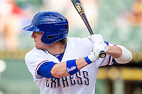 Round Rock Express outfielder Jim Adduci (24) at bat during the Pacific Coast League baseball game against the Salt Lake Bees on August 10, 2013 at the Dell Diamond in Round Rock, Texas. Round Rock defeated Salt Lake 9-6. (Andrew Woolley/Four Seam Images)