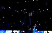 Roger Federer of Switzerland smiles to the crowd as he walks onto court at the ATP World Tour Finals, The O2, London, 2015