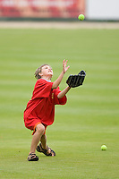 """A young fan competes in the """"catch a fly"""" contest between innings at Fieldcrest Cannon Stadium April 14, 2010, in Kannapolis, North Carolina.  Photo by Brian Westerholt / Four Seam Images"""