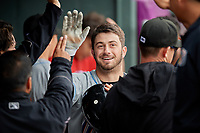 Akron RubberDucks Tyler Friis (38) high fives teammates after hitting a home run during an Eastern League game against the Erie SeaWolves on June 2, 2019 at UPMC Park in Erie, Pennsylvania.  Akron defeated Erie 7-2 in the first game of a doubleheader.  (Mike Janes/Four Seam Images)