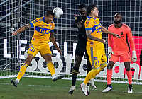 22nd December 2020, Orlando, Florida, USA;  Tigres Francisco Meza  heads the ball clear during the Concacaf Champions League Final between the LAFC and Tigres on December 22, 2020 at Explorer Stadium in Orlando, FL.