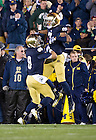 Sept. 22, 2012; Notre Dame wide receiver TJ Jones celebrates with wide receiver Robby Toma after making a catch during the first half against Michigan.  Photo by Barbara Johnston/University of Notre Dame