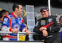 Feb 22, 2009; Fontana, CA, USA; NASCAR Sprint Cup Series driver Sam Hornish Jr (left) talks with David Stremme prior to the Auto Club 500 at Auto Club Speedway. Mandatory Credit: Mark J. Rebilas-