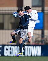 Austin Martz (2) of Georgetown goes up for a header with Jason Gaylord (2) of Old Dominion during the second round of the NCAA tournament at Shaw Field in Washington, DC. Georgeotown defeated Old Dominion, 3-0.