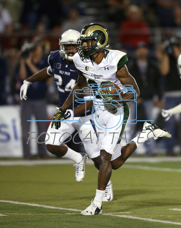 Colorado State's Rashard Higgins (82) scores on a 42-yard pass play against Nevada defender Charles Garrett (24) during the first half of an NCAA college football game in Reno, Nev., on Saturday, Oct. 11, 2014. Colorado State won 31-24. (AP Photo/Cathleen Allison)