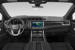 Stock photo of straight dashboard view of 2021 GMC Yukon-XL Denali 5 Door SUV Dashboard