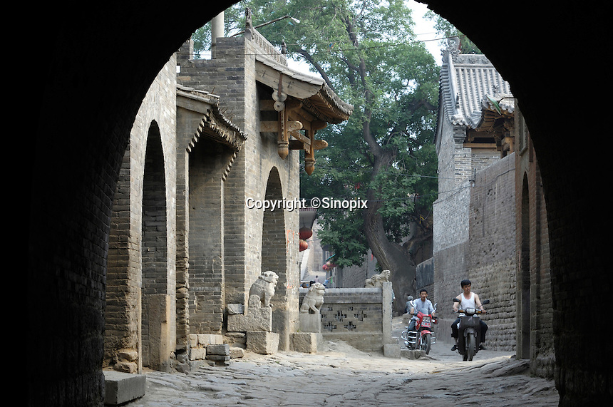 Two men ride motorcycles in Zhangbi Ancient Fort in Jiexiu, Shanxi, China. China government. is going to invest 35 million yuan to develop tourism by building more scenic spots in Zhangbi Ancient Fort..05 Jun 2007.