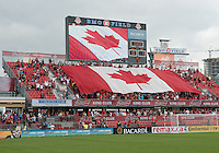 29 June 2013: The Toronto FC fans show support for their country during the opening ceremonies in an MLS game between Real Salt Lake and Toronto FC at BMO Field in Toronto, Ontario Canada.<br /> Real Salt Lake won 1-0.