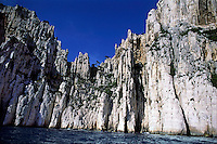 Steep calanques rising from the Mediterranean Sea off the coast of Marseille, France.
