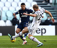 Calcio, Serie A: Juventus - Bologna, Turin, Allianz Stadium, January 24, 2021.<br /> Juventus' Cristiano Ronaldo (l) in action with Bologna's Lorenzo De SIlvestri rl) during the Italian Serie A football match between Juventus and Bologna at the Allianz stadium in Turin, January 24, 2021.<br /> UPDATE IMAGES PRESS/Isabella Bonotto