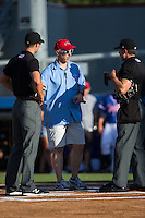Danville Braves General manager David Cross talks to umpires Dillon Wilson (left) and Matthew Brown prior to the game against the Kingsport Mets at American Legion Post 325 Field on July 9, 2016 in Danville, Virginia.  The Mets defeated the Braves 10-8.  (Brian Westerholt/Four Seam Images)