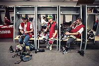 NEW ORLEANS, LA - Photographers Kent Porter, Nick Lammers, and Jon McNally relax in the locker room before Super Bowl XXIV between the Denver Broncos and San Francisco 49ers at the Louisiana Superdome in New Orleans, Louisiana on January 28, 1990. Photo by Brad Mangin.