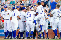 The Durham Bulls celebrate their 4-3 walk-off win over the Charlotte Knights in game one of a double header at Durham Bulls Athletic Park on August 28, 2011 in Durham, North Carolina.   (Brian Westerholt / Four Seam Images)