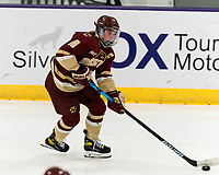WORCESTER, MA - JANUARY 16: Kelly Browne #18 of Boston College brings the puck forward during a game between Boston College and Holy Cross at Hart Center Rink on January 16, 2021 in Worcester, Massachusetts.
