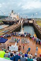 Panama Canal, Panama.  Entering First Lock, Caribbean Side, Heading toward Lake Gatun, While Passengers Watch on Deck.