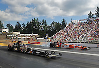 Aug. 7, 2011; Kent, WA, USA; NHRA top fuel dragster driver Del Worsham (near lane) races alongside Spencer Massey during the Northwest Nationals at Pacific Raceways. Mandatory Credit: Mark J. Rebilas-