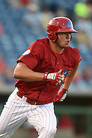 Clearwater Threshers outfielder Dylan Cozens (23) runs to first during a game against the Tampa Yankees on April 21, 2015 at Bright House Field in Clearwater, Florida.  Clearwater defeated Tampa 3-0.  (Mike Janes/Four Seam Images)