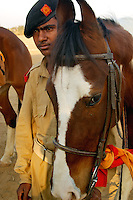 Preparing to ride the Marwari horse, the desert horse of Rajastan, which is an indigeneous breed of India.  These horses are bred at Fort Dundlod India.
