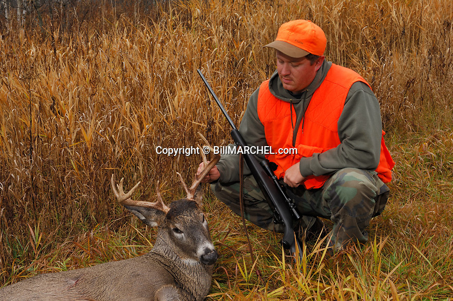 00273-038.06 White-tailed Deer Hunting (DIGITAL) Hunter with scoped rifle poses with whitetail buck with 10 point antlers.  H4F1