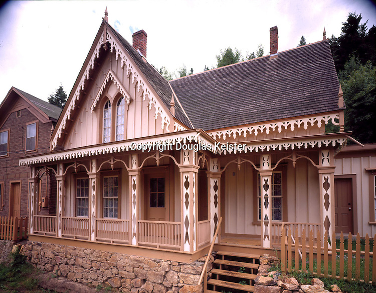 The Lace House Museum <br />Black Hawk, Colorado.  1863.  Built as a wedding present by tollgate keeper Lucien K. Smith for his bride, Mary Germain, the Lace House Museum was restored by the city of Black Hawk in 1976 for its centennial.  The elaborate verge boards, a dripping confection of icicles emphasizes the Gothic verticality of the home.  Note the siding is laid vertically - a typical, Gothic design.  Gothic homes were popularized by A.J. Downing beginning in the 1840's and were fashionable until the 1870's.