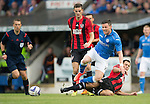 St Johnstone v FC Spartak Trnava...31.07.14  Europa League 3rd Round Qualifier<br /> Michael O'Halloran is tackled by Matej Siva<br /> Picture by Graeme Hart.<br /> Copyright Perthshire Picture Agency<br /> Tel: 01738 623350  Mobile: 07990 594431