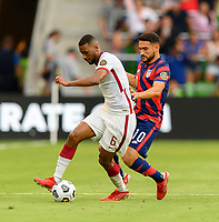 AUSTIN, TX - JULY 29: Cristian Roldan #10 of the United States attempts to steal the ball from Abdelaziz Hatim #6 of Qatar during a game between Qatar and USMNT at Q2 Stadium on July 29, 2021 in Austin, Texas.
