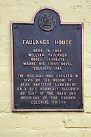 French Quarter, New Orleans, Louisiana.  Pirate's Alley.  Plaque on  William Faulkner House, where in 1925 Faulkner wrote his first novel.