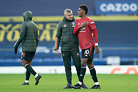 7th November 2020; Liverpool, England; Manchester Uniteds manager Ole Gunnar Solskjaer speaks with Marcus Rashford after the Premier League match between Everton and Manchester United at Goodison Park Stadium