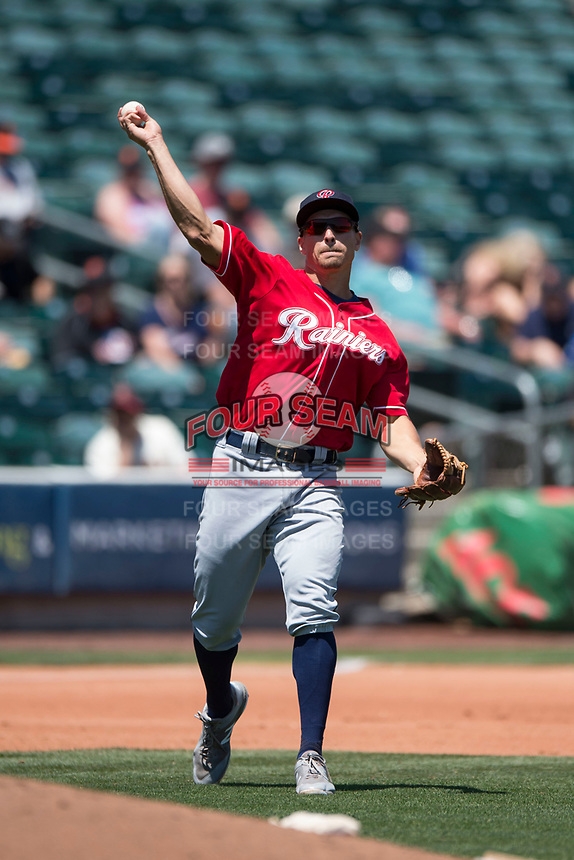 Tacoma Rainiers third baseman Seth Mejias-Brean (21) warms up between innings of a Pacific Coast League game against the Sacramento RiverCats at Raley Field on May 15, 2018 in Sacramento, California. Tacoma defeated Sacramento 8-5. (Zachary Lucy/Four Seam Images)
