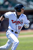 Lansing Lugnuts catcher Drew Millas (12) runs to first base on May 30, 2021 against the Great Lakes Loons at Jackson Field in Lansing, Michigan. (Andrew Woolley/Four Seam Images)