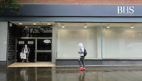 "Pictured: A man walks past a poster of Sir Philip Green on the door of the now closed down BHS store in Oxford Street, Swansea, Wales, UK. Tuesday 13 September 2016<br /> Re: Former owner of BHS, Sir Philip Green has paid a surprise 'visit' to the closed down BHS store in Swansea.<br /> He was spotted in the doorway of the Oxford Street store, which closed its doors for the last time last month.<br /> In his hand was a BHS shopping bag with money spilling out of it.<br /> Sir Philip had owned BHS before selling it for £1 last year.<br /> He is claimed to have taken millions out of the company in dividends and left behind a £571m pensions deficit.<br /> Alongside the poster are the words: ""Thankyou for your custom Sir""."